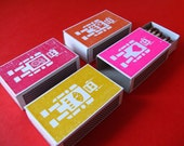 Robot match boxes. Set of 4 match boxes in red, orange, pink and yellow.