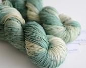 Hand Dyed Tweed Sock Yarn - Superwash Merino / Nylon 438 Yards - Ent - Pine Green and Cream