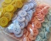 Pastel assortment of plastic buttons