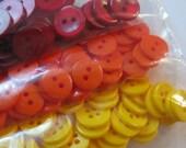 Warm colors assortment of plastic buttons