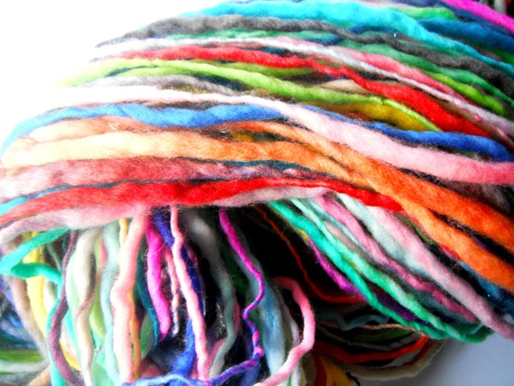 handspun wool yarn .. 116 meters or 126 yards .. thick and thin 1 ply rainbow with sparkle.. little rainbow 1