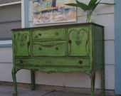 Curvy green distresed antique sideboard