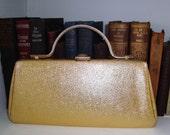 Vintage metallic gold lady purse