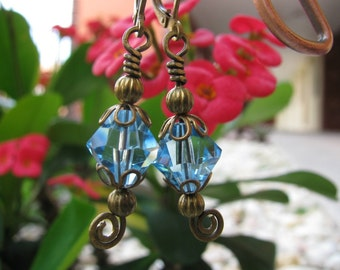 Aquamarine Swarovski Crystal Earrings with Brass Floral Bead Caps and Spirals