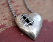 Sutured heart necklace sterling silver