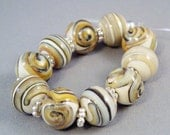 SALE Glass Beads Golden Beige Neutral Scrolls and Spirals on Ivory Set of Round Beads by Solaris Beads 1747