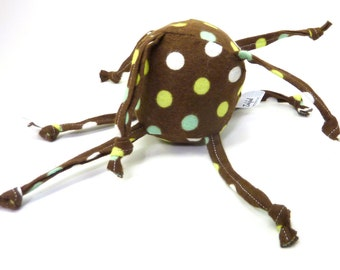 Unique Baby toy - Soft ball with strings - brown with white, green and blue spots