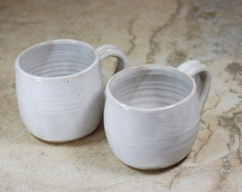 PAIR of white stacking mugs/ coffee/ tea/ ceramic/pottery M25