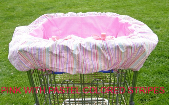 Shopping cart cover for toddler girls in bubble gum pink with pastel stripes. Coordinating tote bag.