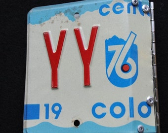 Recycled Colorado license plate photo album