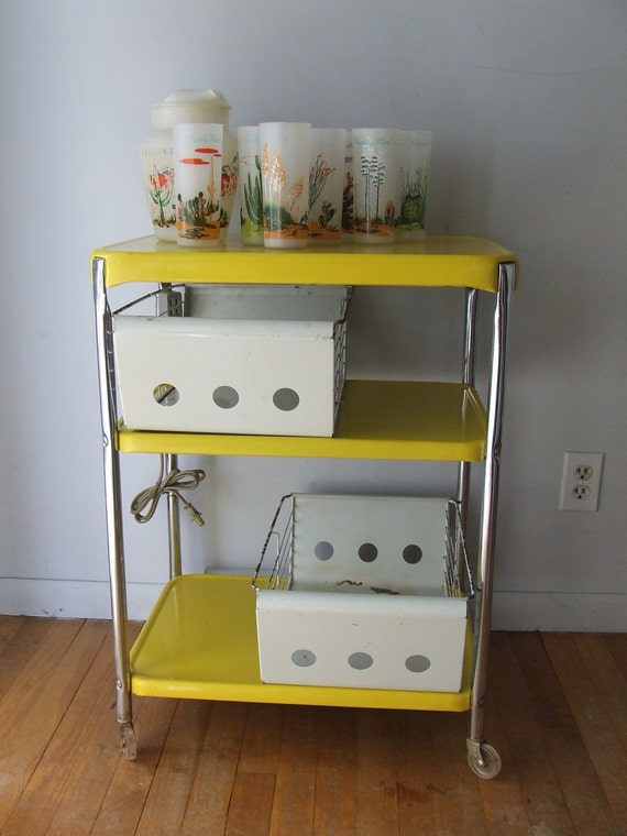 bright yellow metal rolling cart tea serving office cosco table 1960s