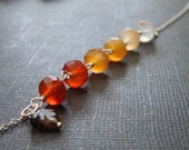 Fall leaves - shaded carnelian rondelles necklace with a tiny smokey quartz leaf - shades of red, orange, yellow, and brown