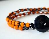 Halloween jewelry - Black hemp crochet bracelet with bright orange beads and a black button clasp