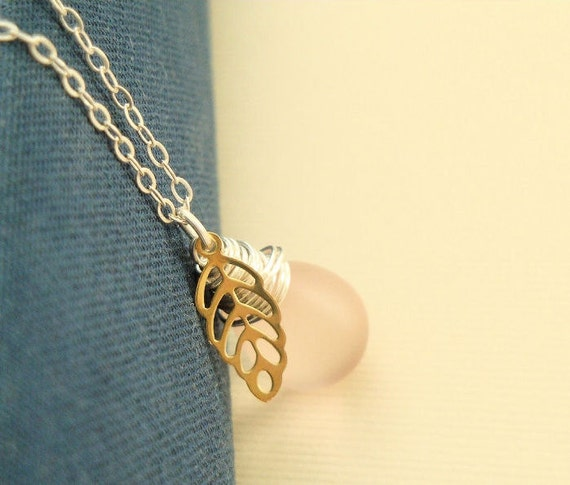 Frosted pink pear berry necklace with raw brass leaf and sterling silver