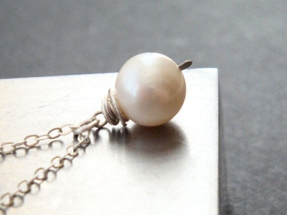 White pearl solitaire necklace in sterling silver