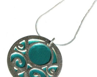 Small reversible Swirls pendant with Aqua front and Jet back
