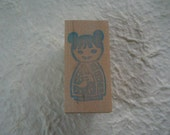 Stamp. Kokeshi Doll with knotted hair.