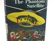 1956 Tom Swift on the Phantom Satellite.  First edition and first printing of the ninth book in the Tom Swift Jr. series.
