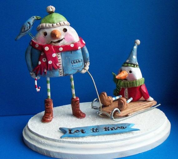 Sale-Snowmen with wooden sled- clay folk art sculpture