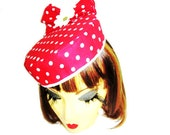 Red and white polka dotted pillbox hat with bow