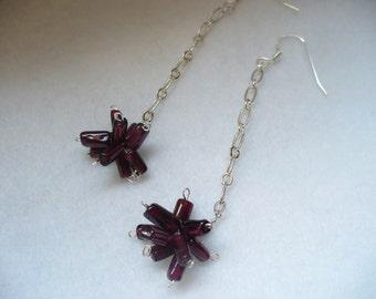 Garnet starburst dangle earrings