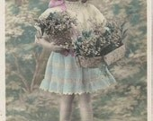 Antique French recolored postcard little girl with bouquets
