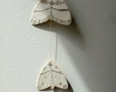 moths - paper and wax string mobile