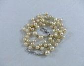Cream pearl and linen cord