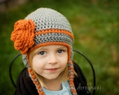Custom made hat with over sized flower, earflaps and ties for infants, toddlers or children.