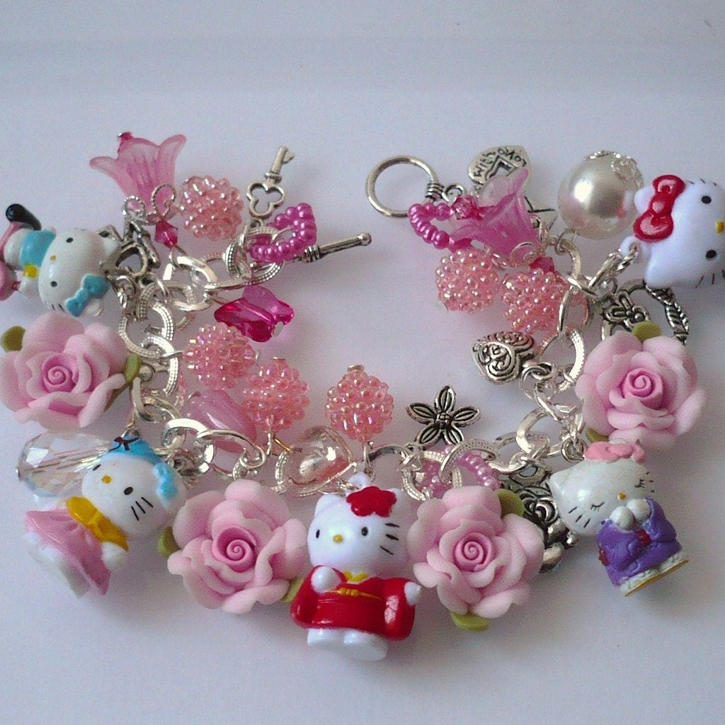 two hello kitty charm bracelets please do not buy for