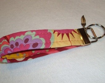 Beautiful wristlet key fob with Amy Butler fabric and contrasting fabic inside with a cute feather charm added