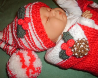 SALE . . Cute baby cocoon with matching hat and toy Santa . . SALE.