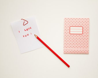 Notepad for Valentine day, with a red heart pattern