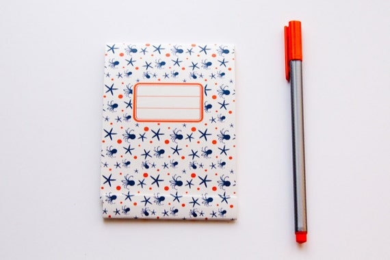 Notepad, orange and navy blue pattern with octopus and sea stars