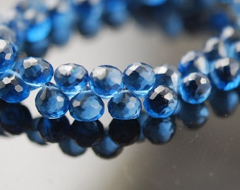 1/2 strand of London Blue Topaz color onions