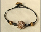 Bracelet with Antique Buttons Brass and Black Floral