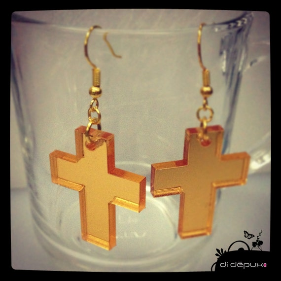 Gold laser cut crosses mirrored