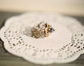 Midnight Flower - adjustable antiqued brass filigree ring with sparkling iridescent blue crystal