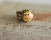 "Adjustable vintage locket ring with fiery pink-orange glass opal cabochon - ""of Dragons and Knights"". Autumn jewelry."