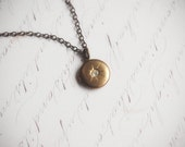 Tiny vintage brass starburst locket necklace - Northern star