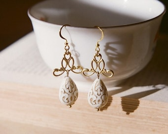 Ornate art nouveau filigree earrings in off white and gold