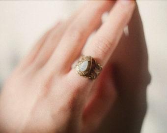 Moonlit leaf - Handmade adjustable size locket ring with light blue iridescent moonstone glass leaf cabochon