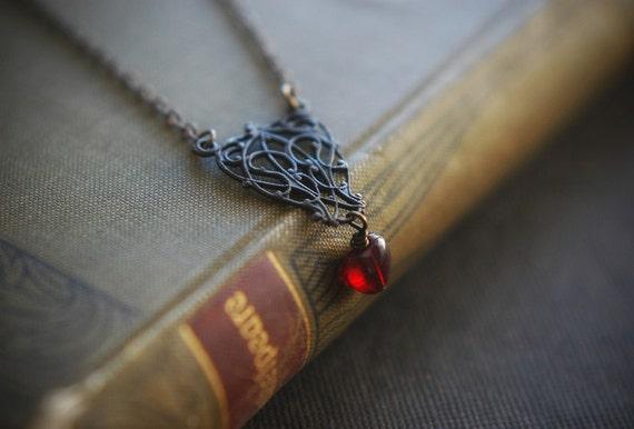 Dark heart. Blackened brass filigree necklace with vintage garnet glass heart bead.