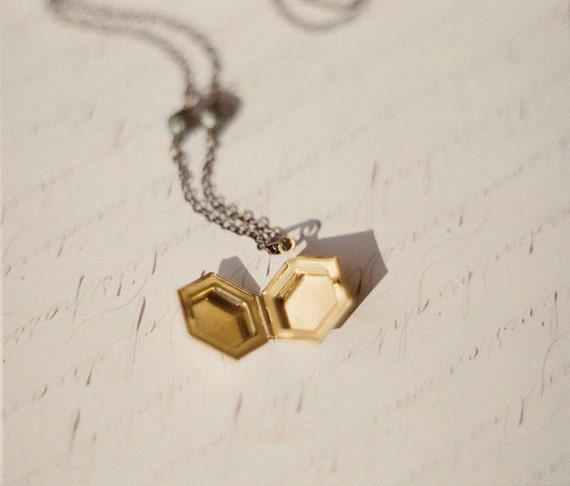 Magical hexagon locket necklace with with faceted pyrite beads.