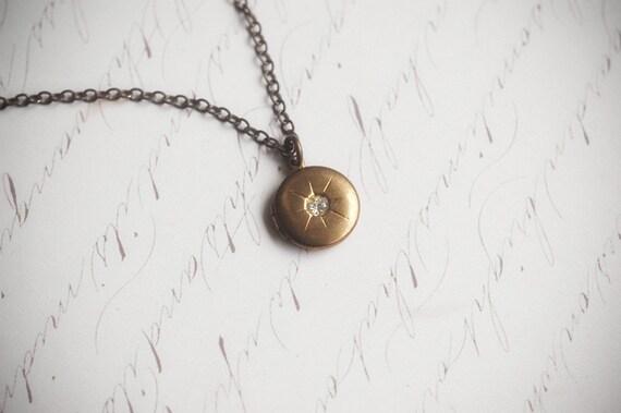 Tiny vintage brass starburst locket necklace - Northern star