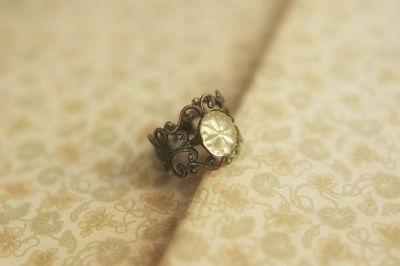 Adjustable antiqued brass ring with pale yellow vintage cut glass cabochon - Evening Star