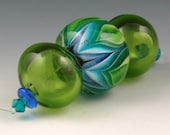Andie's Glass - Bloom Series Focal Bead with 2 Transparent Olive Hollow Beads