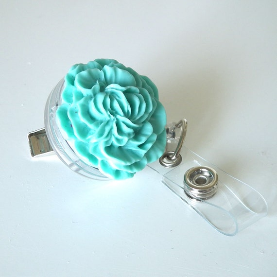 Retractable Badge Reel Turquoise Carnation on Clear Reel with Alligator Clip