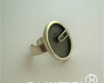 Sterling Silver Ring with 3 Raw Diamonds in Oxidized Oval Frame