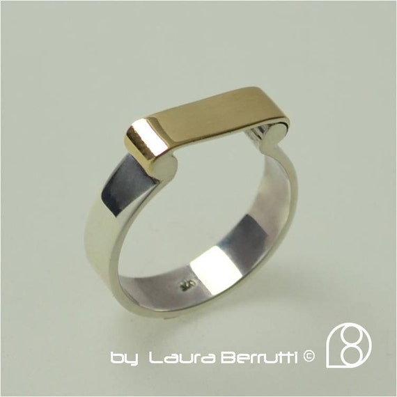 Sterling silver and 14K gold band with a bridge